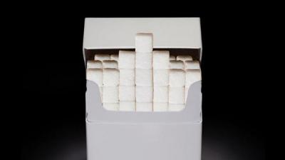 أطباء بريطانيون: السكر أكثر خطورة من التدخين