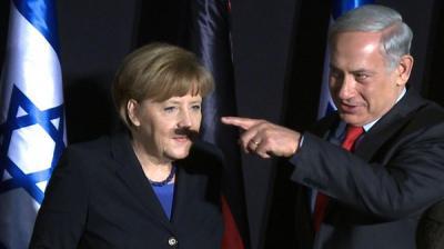 نتنياهو يرسم شارب هتلر على وجه ميركل