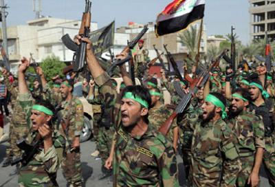 """قوات الحشد الشعبي """" الشيعية """"  تدمج بشكل رسمي في الجيش العراقي بعد إقرار البرلمان"""