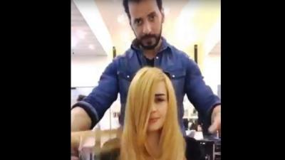 """بالفيديو.. مصفف شعر بدبي  يستخدم شوكولا """"النوتيلا"""" والحليب المكثف لصبغ شعر الفتاة"""