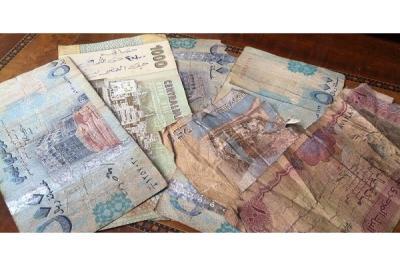 تحذيرات من مخاطر انهيار العملة الوطنية