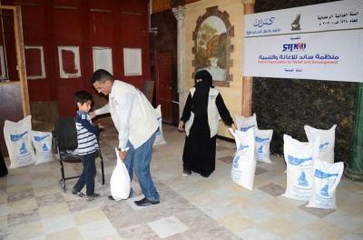 ساند وكمران تدشنا توزيع (80) سلة غذائية في العاصمة صنعاء