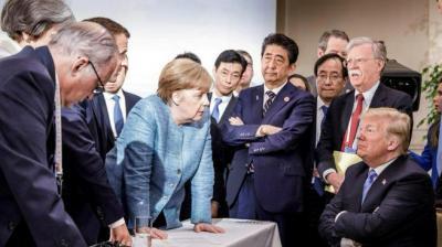 """صورة قادة الدول السبع مع ترامب """"مُلخّص عام 2018"""" وتشعل وسائل الإعلام"""