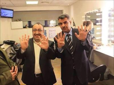 صورة - خالد الآنسي ويحيى العابد يتفقان على شعار واحد عقب برنامج الإتجاه المعاكس